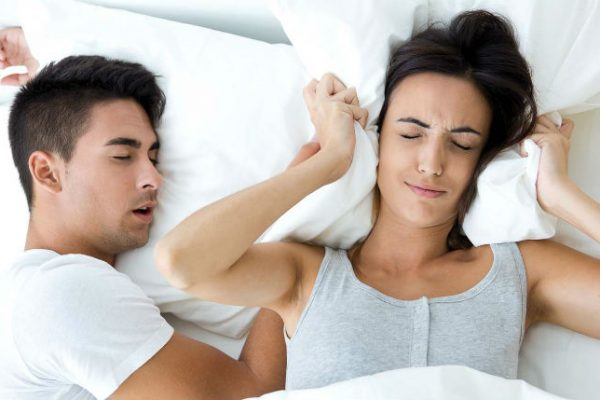 Man snoring woman unhappy