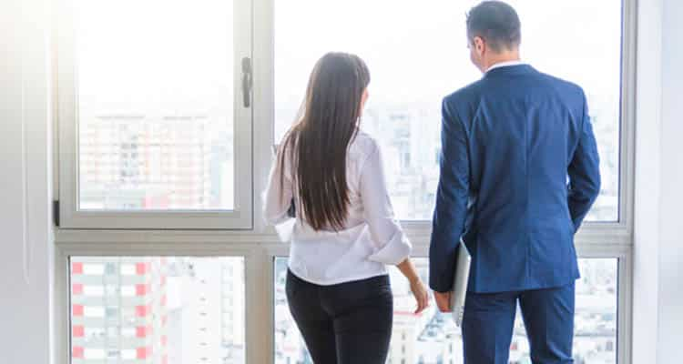 Woman and man together in office
