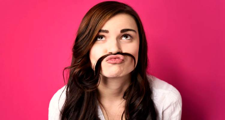 A-pretty-girl-using-her-long-hair-as-a-moustache