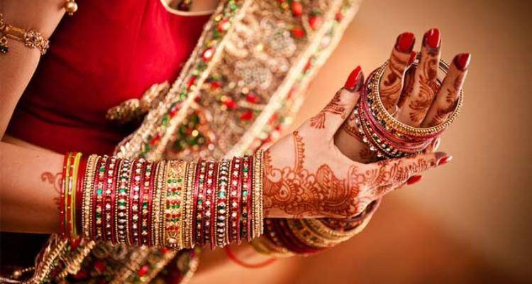 Indian bride wearing bangles