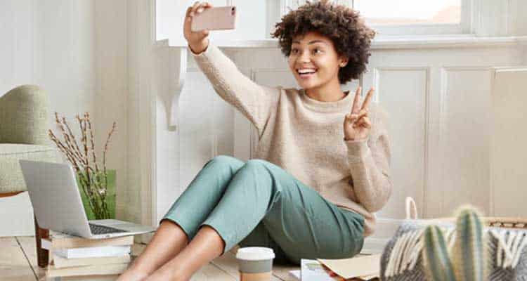 Woman makes video call with cell phone