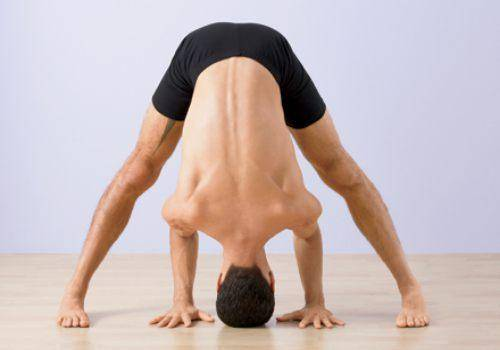 Wide legged forward fold yoga pose