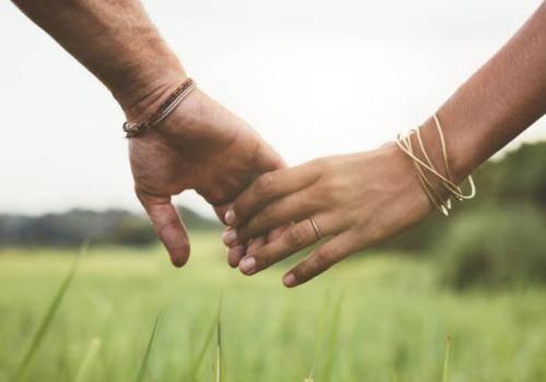 couple in garden holding hands