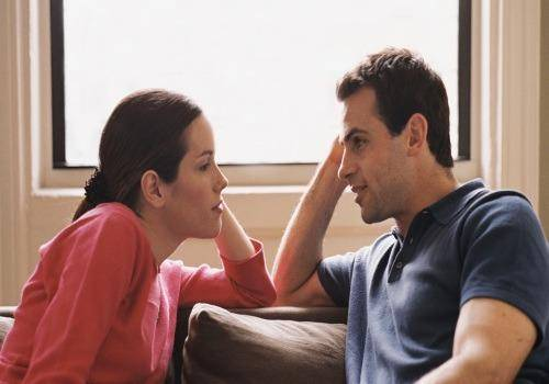 couple talking seriously in room
