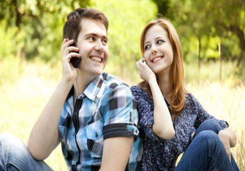 couple talking on phone in garden