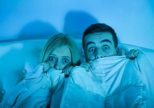 couple watching horror movie