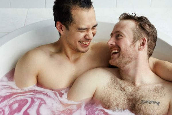 Gay couples in bath tub