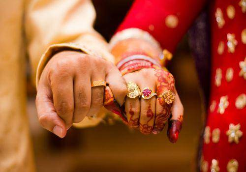 indian married couple hands