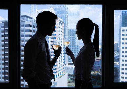 man and woman at work place. signs he is cheating on you with a co-worker