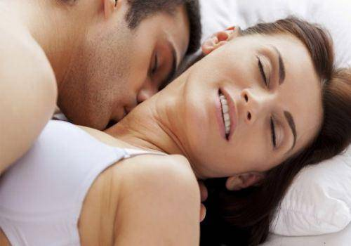 man-and-woman-getting-intimate-in-bed