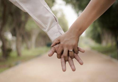 man-and-woman-hand-in-hand-on-the-road
