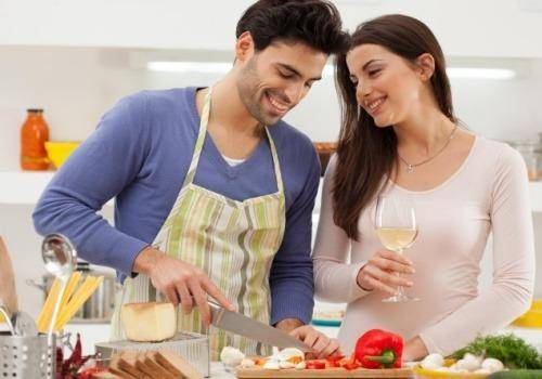 man cooking for woman