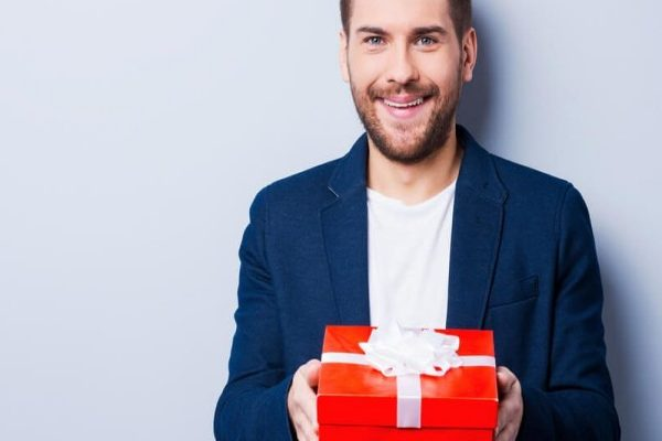 man with gift in hand