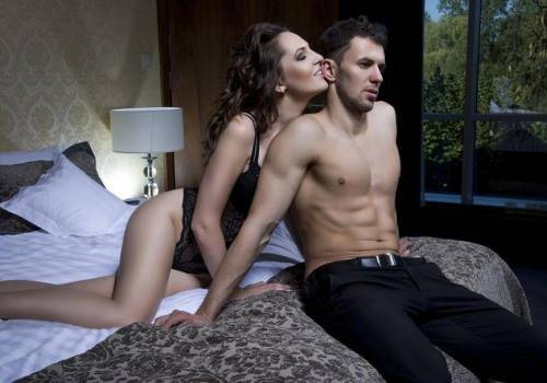sexy lady with man in bed
