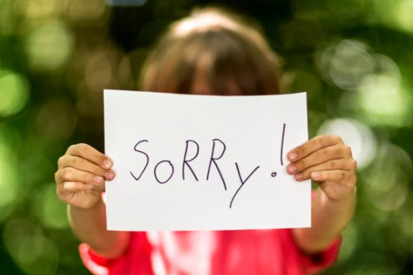 Girl saying sorry
