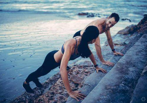 couple-doing-push-ups-together