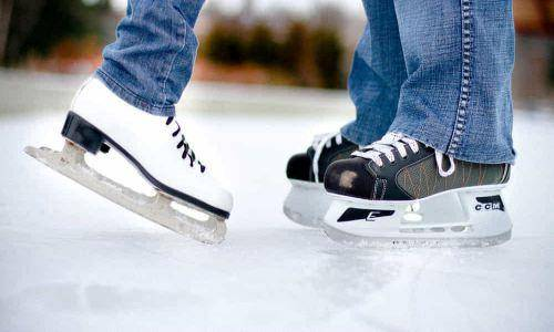 couple foot doing ice skating