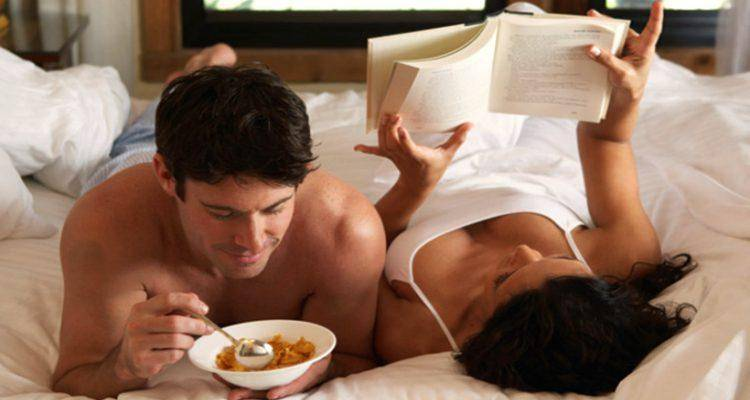 couple on bed while on vacation