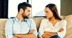 couple seeing each other while sitting on couch