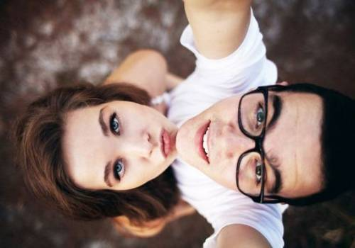 couple taking selfie go up