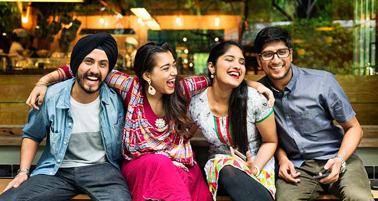 YOung indian couple with friends
