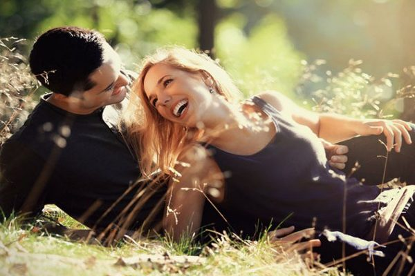 happy man and woman lying on the ground