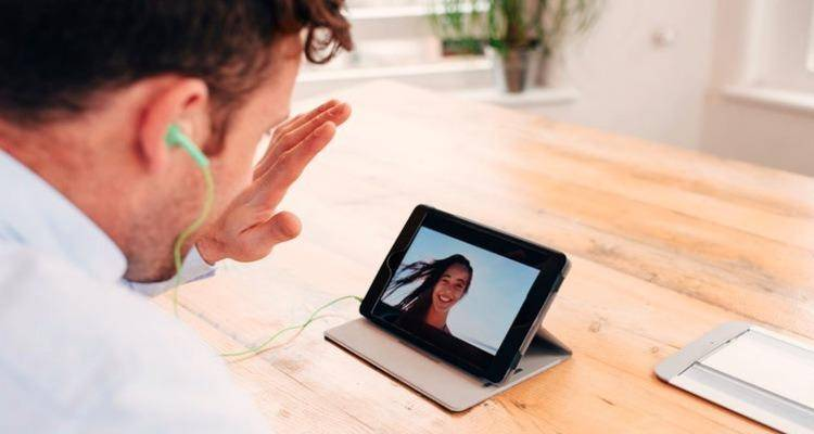 man talking to girl via video call