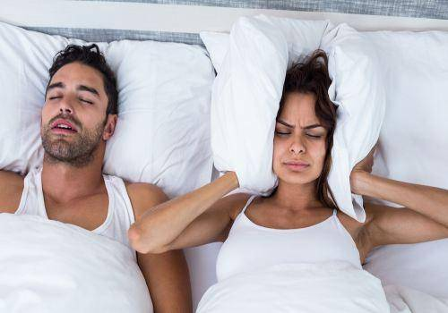 man-snoring-in-bed