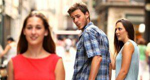 man watching other woman