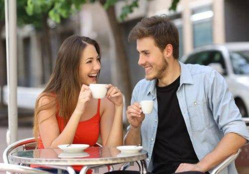 man and woman having a coffee