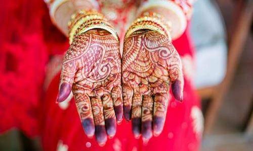 mehendi in the hand of new bride