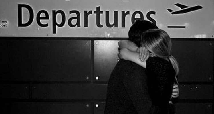 Couple hugging at airport