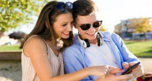 couple looking into phone