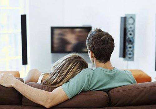 couples intimate watching tv