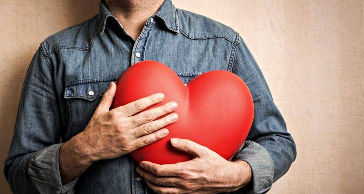man having heart in hand