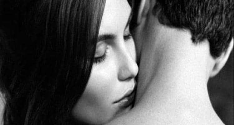 Woman kissing on neck