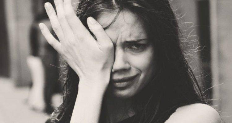 Black and white close up of woman crying