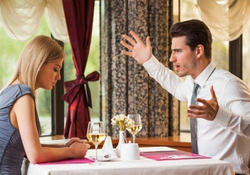 angry man on woman in restaurant