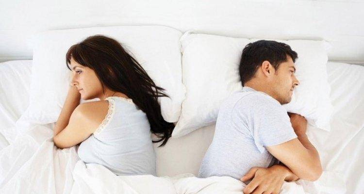 couple not talking to each other in bed