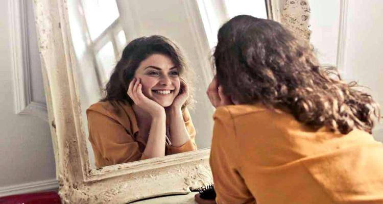 happy lady seeing in mirror
