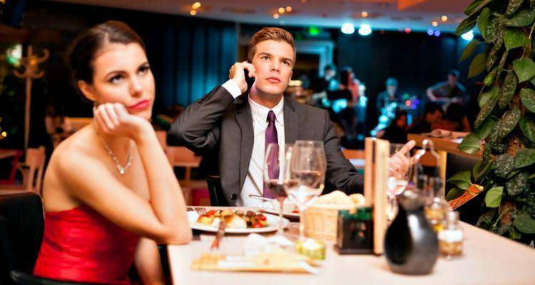 man on phone on date