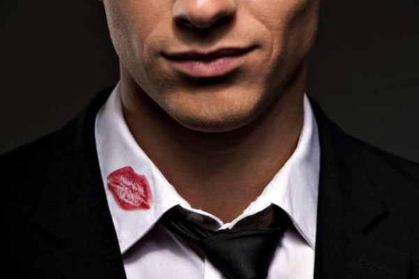 man with a lipstick mark