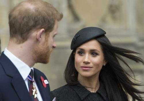 Meghan in black dress with harry