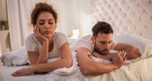 sad couple not talking in bed