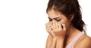 young-girl-crying-into-her-hands