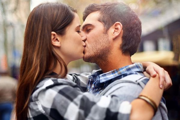 couple kissing and hugging in public