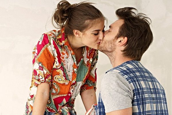 couple kissing in white background
