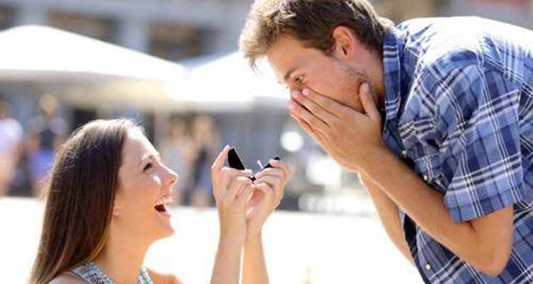 Girl proposing a boy with ring
