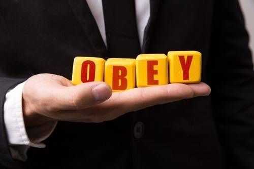 obey letters in man's hand