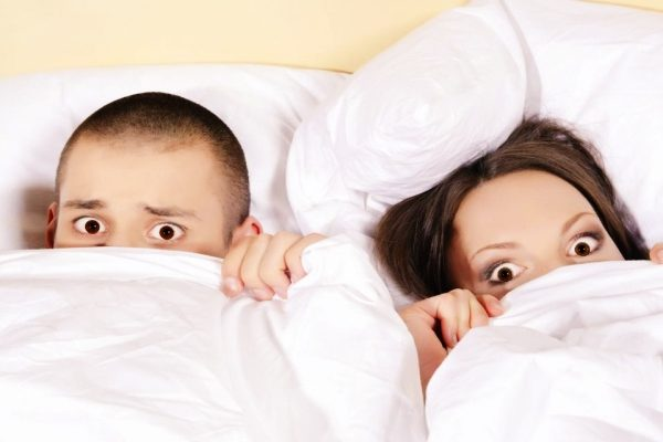 shocked couple in bed